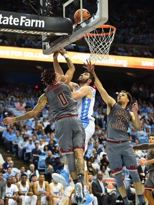 North Carolina Tar Heels forward Luke Maye (32) shoots as Boston College Eagles guards Ky Bowman (0) and Jordan Chatman (25) defend in the second half at Dean E. Smith Center.