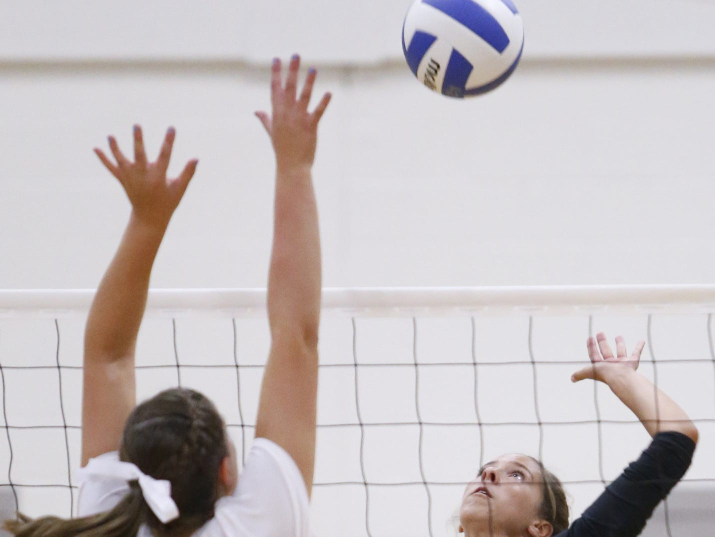 Padua's Claire Bisson hits in the second game of Padua's 3-0 win at Wilmington Friends on Thursday.
