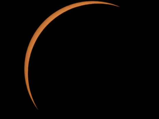 The Moon is seen passing in front of the Sun at the