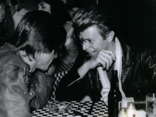 "David Bowie (right) and Iggy Pop in Royal Oak in June 1990, during a listening party for the latter's ""Brick By Brick"" album."