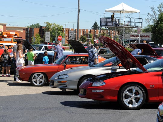 The General Motors Design staff members bring their cars to the Northwood Shopping Center parking lot for the public to view as part of the 2014 Woodward Dream Cruise.