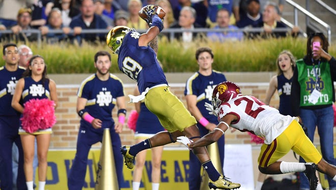 Oct 21, 2017; South Bend, IN, USA; Notre Dame Fighting Irish wide receiver Kevin Stepherson (29) catches a pass for a touchdown as USC Trojans cornerback Isiah Langley (24) defends in the first quarter at Notre Dame Stadium. Mandatory Credit: Matt Cashore-USA TODAY Sports