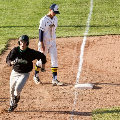 Yorktown's Cole Barr rounds the bases after a line
