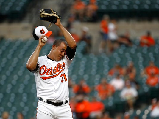 Baltimore Orioles starting pitcher Ubaldo Jimenez pauses after Oakland Athletics' Matt Olson singled during the first inning of a baseball game in Baltimore, Tuesday, Aug. 22, 2017. Jimenez gave up three runs in the first. (AP Photo/Patrick Semansky)