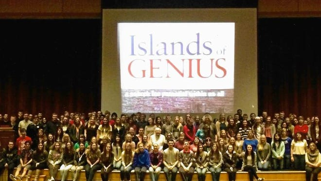 """Dr. Darold Treffert with students from Fond du Lac High School during his """"Islands of Genius"""" presentation."""