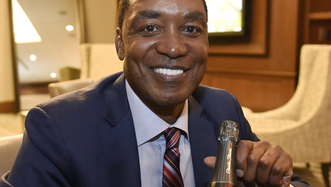 Isiah Thomas display a bottle of his Cheurlin Champagne at the Presidents Club before the game Wednesday night at The Palace of Auburn Hills.