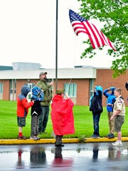 Boy Scout Troop 28 raises the flag at the Tuscarora Wildlife Education Project's 3rd Annual Field Day on Saturday, May 21, 2016.