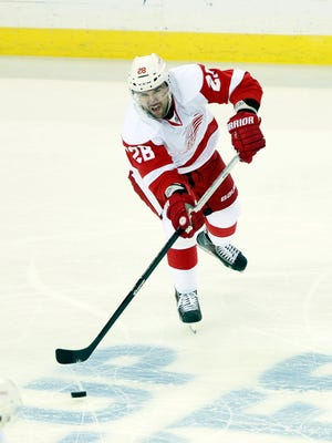 Detroit Red Wings defenseman Marek Zidlicky passes the puck against the Tampa Bay Lightning during Game 5.