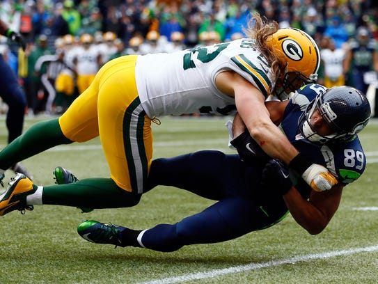 Seattle Seahawks receiver Doug Baldwin is tackled by