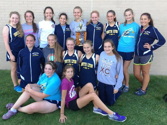 The South Lyon girls cross country team finished first