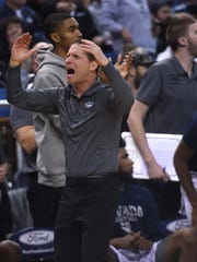 Nevada head coach Eric Musselman tries to fire up the crowd during a game against Wyoming earlier this season.