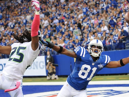 Colts wide receiver Darrius Heyward-Bey can't haul in a pass while being pressured by Seattle cornerback Richard Sherman in the first half of the game. The Colts beat Seattle 34-28 in Sunday's game at Lucas Oil Stadium on October 6, 2013.