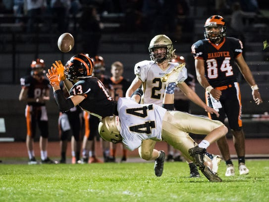 Delone Catholic' A.J. Knobloch (44) puts a hit on Hanover's