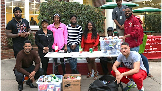 The Alpha Xi chapter of Kappa Alpha Psi Fraternity Inc. collects food donations for the Kearney Center.
