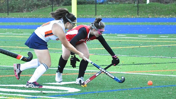 Fox Lane defender Claudia Hirsch (r) knocks the ball away from Horace Greeley's Sophie Berkowitz.during the 2017 Section 1 Class A field hockey playoffs.