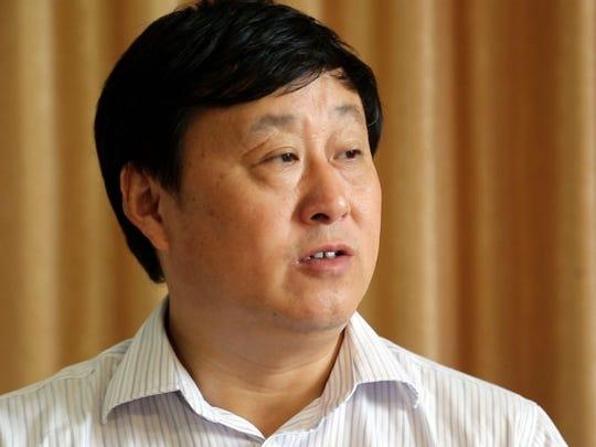 Shang Hai Farm CEO Zou Guang Bin.