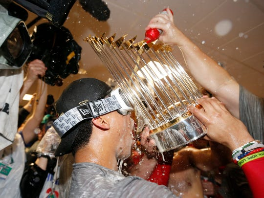 Juan Soto (22) of the Washington Nationals celebrates in the locker room after defeating the Houston Astros in Game Seven to win the 2019 World Series at Minute Maid Park in Houston,. The Nationals defeated the Astros 6-2.