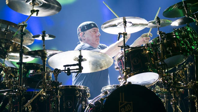 Rush drummer Neil Peart, shown here playing a concert last year, chronicled his battle with depression after suffering two major losses in his memoir, 'Ghost Rider: Traveling on the Healing Road.' Peart hit the road for a 55,000 motorcycle trip after losing his  wife and daughter.
