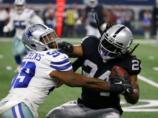 Dallas Cowboys linebacker Anthony Hitchens (59) tries to stop Oakland Raiders running back Marshawn Lynch (24) on a run in the first half of a preseason NFL football game, Saturday, Aug. 26, 2017, in Arlington, Texas. (AP Photo/Ron Jenkins)