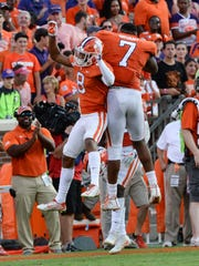Clemson defensive back A.J. Terrell (8), left, celebrates his interception with teammate defensive end Austin Bryant (7) against Boston College during the fourth quarter in Memorial Stadium at Clemson on Saturday.