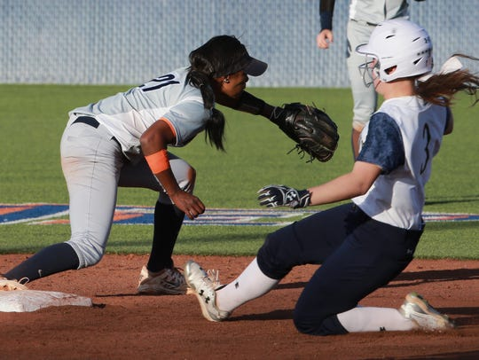 UTEP shortstop Cortney Smith waits for the throw to