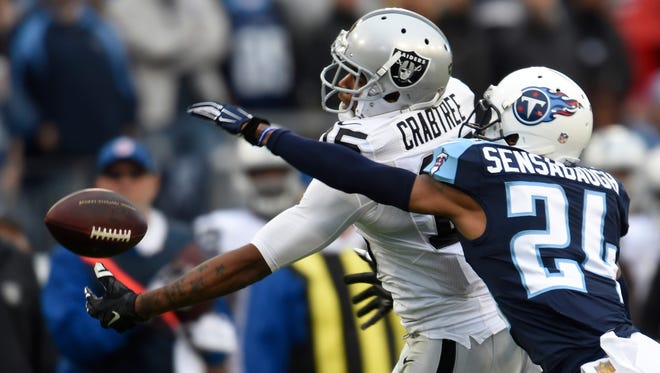 Raiders wide receiver Michael Crabtree (15) catches a pass against Titans cornerback Coty Sensabaugh (24) in their game last month.