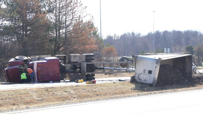 A semi truck flipped over on the eastbound lane of US 30 by the I-71 interchange on Tuesday blocking traffic on the highway.