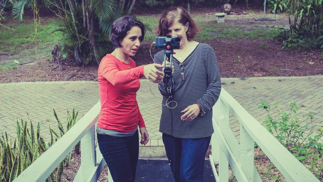 "Marilu Holmes and Wendy White set up the perfect shot for their short film ""Thinking Out Loud."""