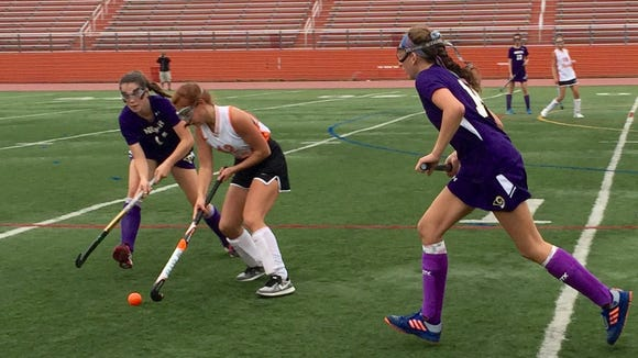 Clarkstown North's Maeve Downes (left) defendes against