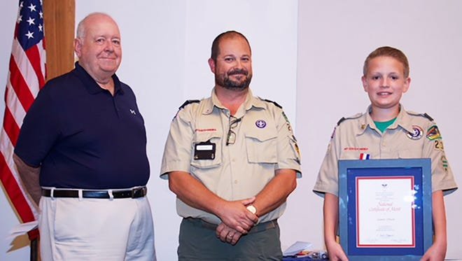 James Olsen was awarded the Boy Scouts of America's National Certificate of Merit for heroic deeds and life-saving actions during Marco Island Troop 234's Court of Honor on Friday, Feb. 23. Last November, Olsen was preparing to eat lunch at Marco Island Charter Middle School and there was with an adult volunteer who suffered a medical emergency. Because of the training he received in scouting, Olsen immediately recognized a need for help and instructed another student to notify school staff to call an ambulance. The adult was transported and recovered. In addition to the National Certificate of Merit from the BSA, Olsen was presented with the United Methodist Church Good Samaritan Award. Above, Tom Pollack, Wesley United Methodist Church; Craig Tirrell, Boy Scout committee chair; and Olsen. More Troop 234 photos, 11B.