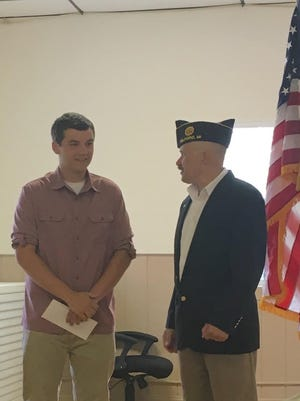 American Legion Post 216 Commander Rich Cherf handed over a $1,000 scholarship check to Lakeland High School senior David Vernon, who read his essay to legion members. American Legion Post 216 is located at 510 Commerce Road in Milford (across from the Kroger parking lot). Meetings are the third Tuesday of the month from 7-830 p.m.