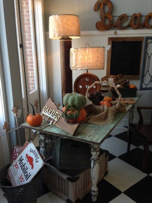 An old barn door forms the centerpiece of a new table.