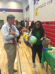 Pike Road School (PRS) learners teach Mayor Gordon Stone about different countries at the first-ever PRS World Fair.