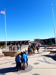 At Four Corners Monument, visitors travel from all