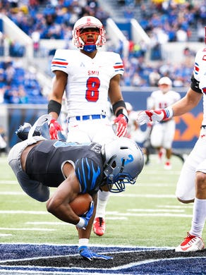 Memphis receiver Anthony Miller (bottom) dives into
