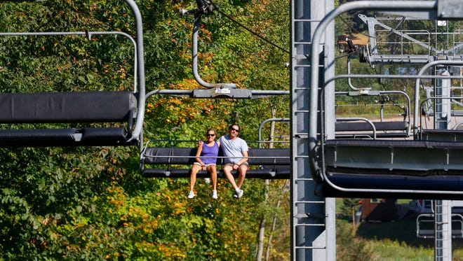 People enjoy the fall chairlift rides Sunday, September 24, 2017, at Granite Peak in Wausau, Wis.