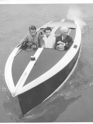 Famed boat builder and power boat racer Gar Wood, right, cruises down the St. Clair River in one of his company's Chris-Craft runabouts. Woodand Chris-Craft helped invent the recreational boating industry from a factory Algonac. Chris-Craft started in Algonac in 1906 with the founding of the C.C. Smith Boat and Engine Co. The name changed officially to Chris-Craft in 1930. The factory officially closed in 1986, although the last boats were made there in 1970 after the company was sold.