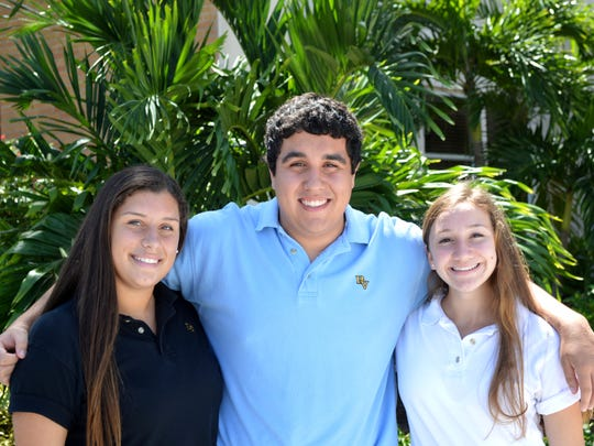 Bishop Verot students Alexis Verwoert, Joseph Zolik and Hanna Arcentales were honored for test scores.