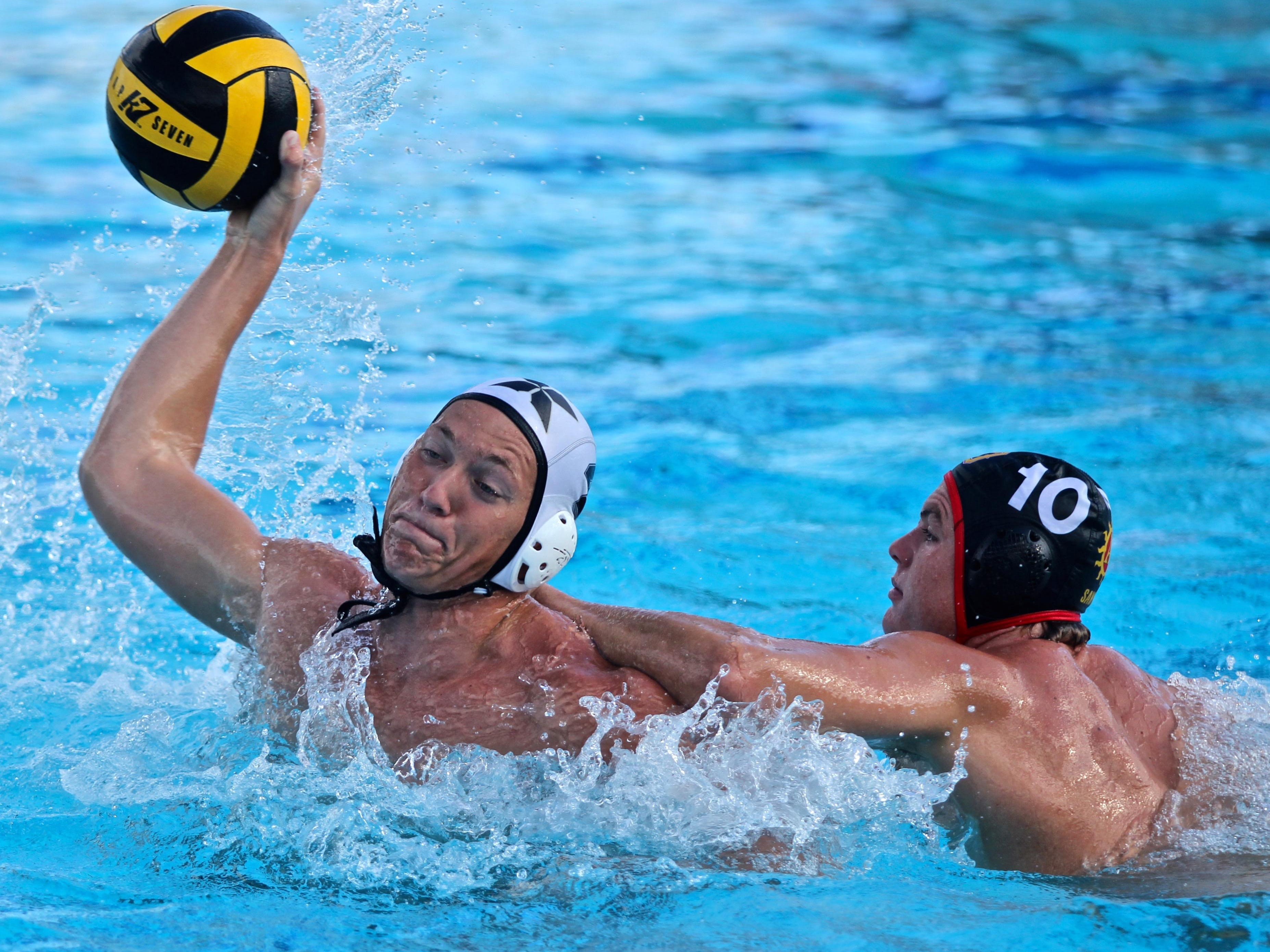 Xavier Prep's Troy Boydstun (4) attempts to pass the ball during an away match with Palm Desert on Tuesday.