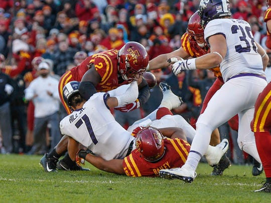 Iowa State linebackers Willie Harvey (No. 2) and JaQuan Bailey force the ball away from Texas Christian University quarterback Kenny Hill on Saturday, Oct. 28, 2017, at Jack Trice Stadium in Ames.