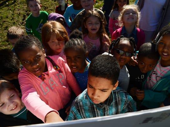 Kegotank Elementary School students look over a site