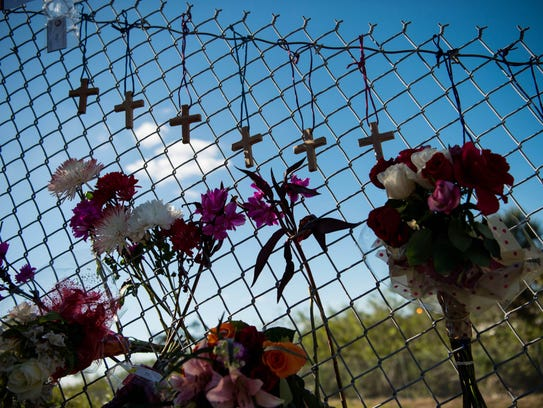 A small makeshift memorial is seen under the Sawgrass