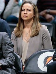 Becky Hammon, a former CSU All-American and the first full-time female assistant coach in the NBA, watches from the San Antonio Spurs bench Friday night during a game against the Denver Nuggets at the Pepsi Center.