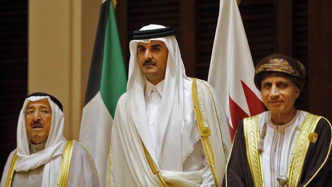 Emir of Qatar Tamim al-Thani, center.