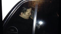 Eric Frein is seen in the back of a police car following