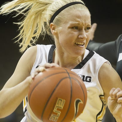 Iowa's Whitney Jennings drives past Northwestern's Ashley Deary during their game at Carver-Hawkeye Arena on Wednesday, Jan. 15, 2015.