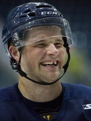Matt Marquardt, a member of the Florida Everblades has fun with teammates during a practice Friday.