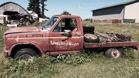 """Dennis Gehrke's old Ford truck """"Wreckreation"""" that he used to pull with sits out in a field near his house."""
