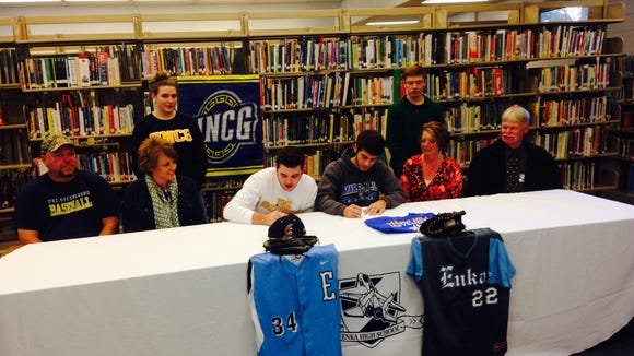 Enka's Matt Frisbee (UNC Greensboro), left, and Austin Marler (Mars Hill) have signed to play college baseball.
