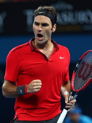 Roger Federer reacts to winning a point in the men's final match against Milos Raonic during the Brisbane International.